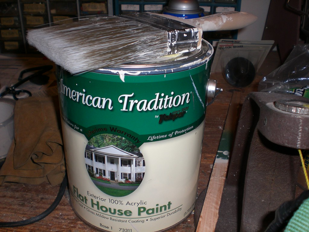 american tradition a can of house paint and a brush in