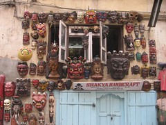 Colorful wooden masks represent all sorts of characters