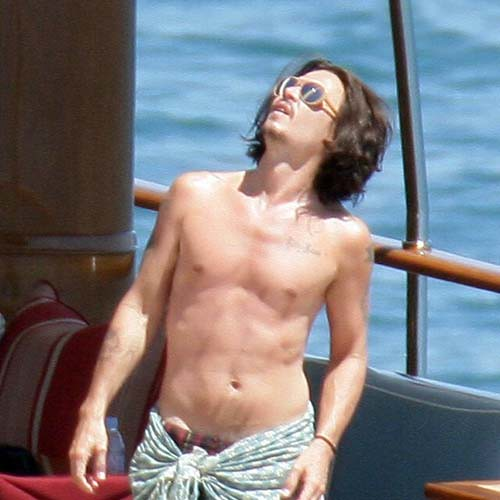 Johnny depp goes shirtless in Italy | click | Hollywood reporter ... Johnny Depp