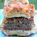 Herb and Pepper Meatloaf with Caramelized Onions on a Biscuit