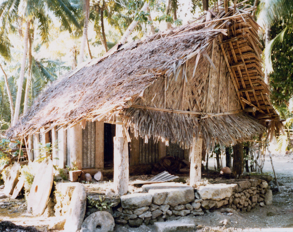 Old Style House With Thatched Roof Stone Foundation And