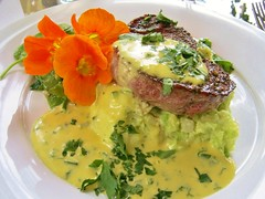 Pangea Filet Mignon with a Cilantro Jalapeño Béarnaise Avocado mashed Potatoes and Ginger Snap Peas