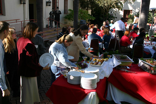Attendees serve themselves breakfast at Breakfast with the President | by California State University Channel Islands