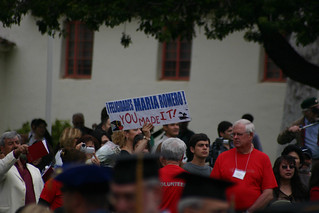 Attendees with signs for Graduates | by California State University Channel Islands
