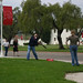 Paul Adalian plays baseball with students during Dolphin Fountain Dedication
