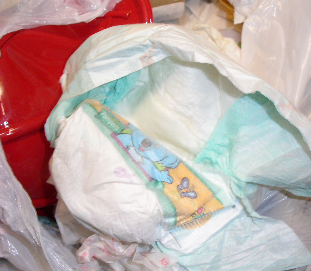 Girl wetting diaper in office 2