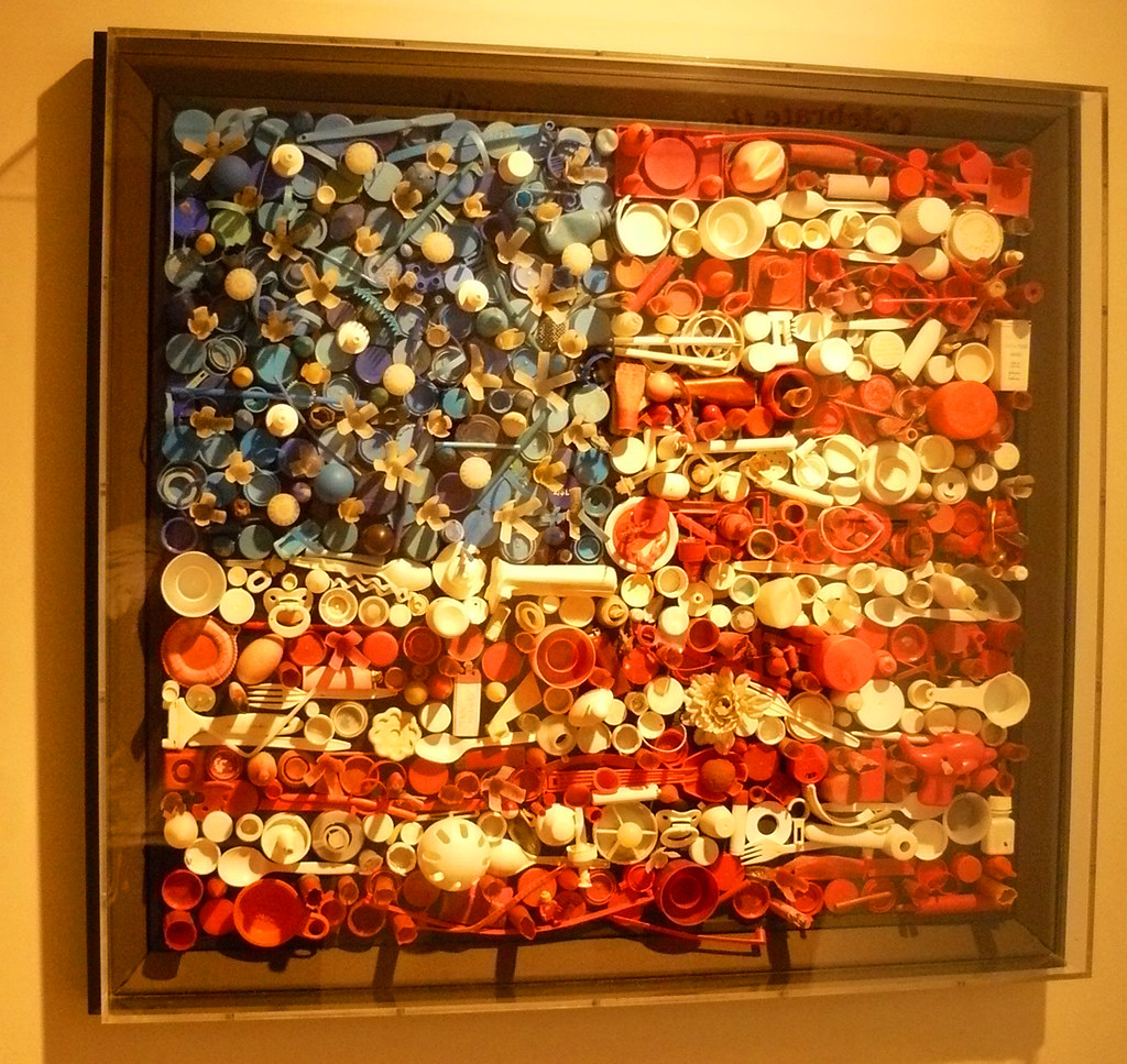 Flag Of Recycled Items On Display At The Art Museum