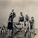 5 young women 1 young man on raft 1930's