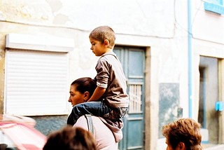 Mother with kid on piggyback | by Miguel Pires da Rosa