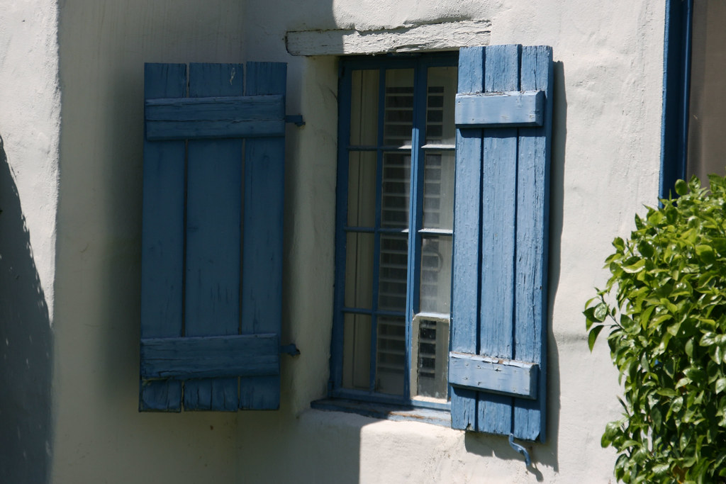 Mission style architecture window and shutters in one for Mission style shutters
