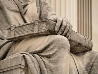 "Closed Book With Clasps On The Lap Of Robert Ingersoll Aitken's ""Past,"" On The North Side Of The National Archives (Washington, DC) 