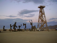 oil derrick and the statues kneeling before it | by skampy