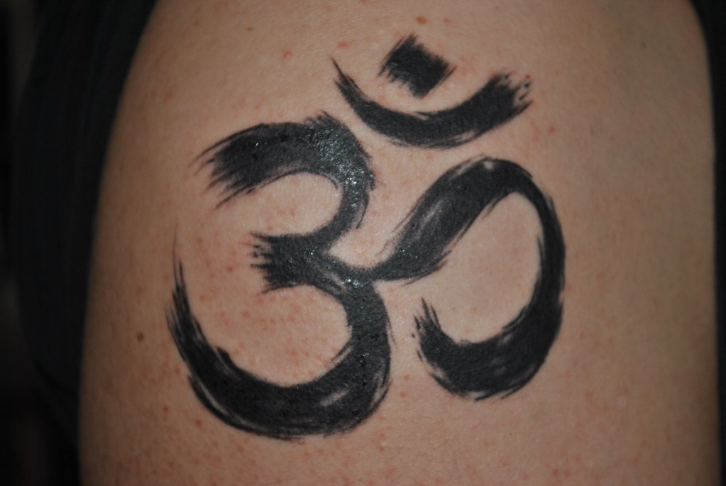 The om symbol today my brother in law sister and i for New tattoo laws