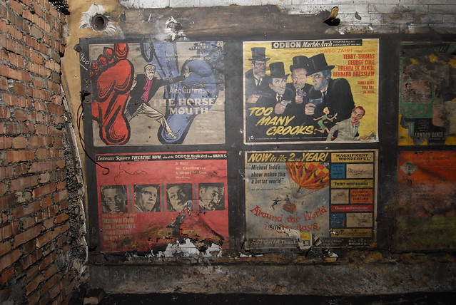 Old film movie posters in disused area at Notting Hill Gate tube station, London - 2010
