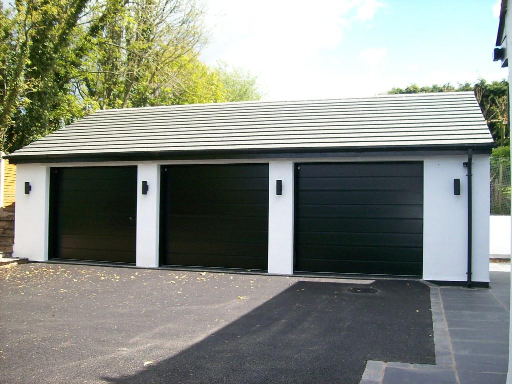 black garage doors3 Black Carteck Sectional Garage Doors  3 Black Carteck Cen  Flickr