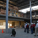 Faculty and staff stand in center of what will be the Broome Library