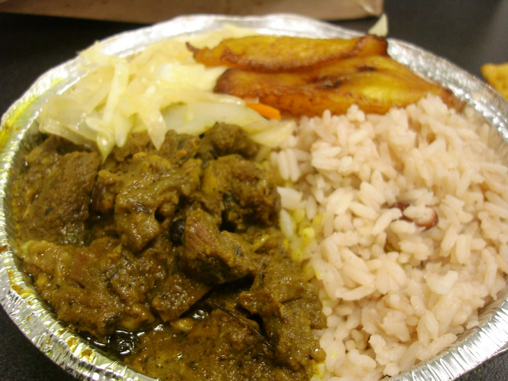 curried goat w/ rice steamed cabbage  plantains  read