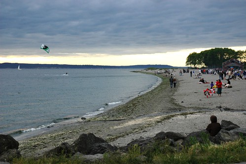 kite surfing gray overcast warm summer evening golden gardens park seattle washington usa