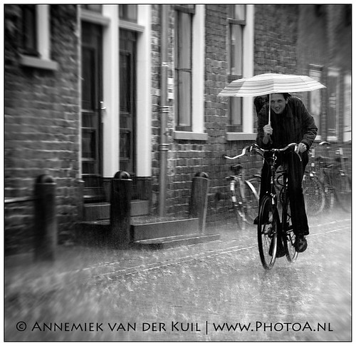 Cycling through the rain | by PhotoA.nl
