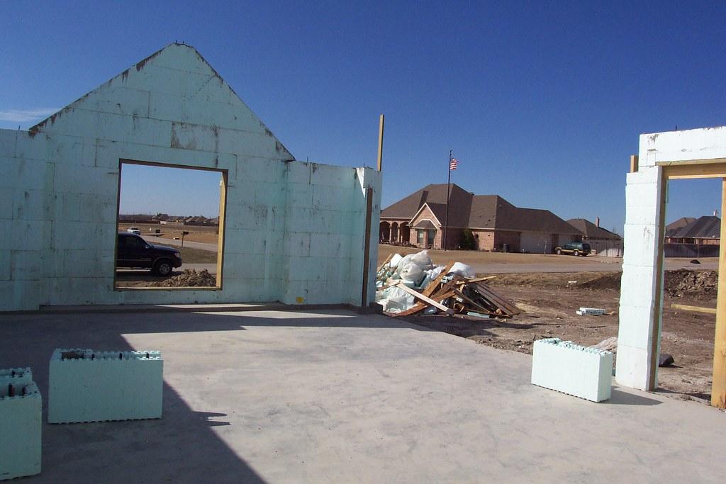 18 ft wide garage door awaiting top beam 8 ft high for 30 foot wide garage door