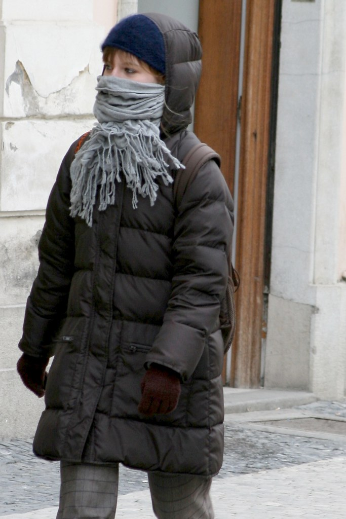 Young Girl In Cold Winter Prague Hood Up In Puffy Downcoat