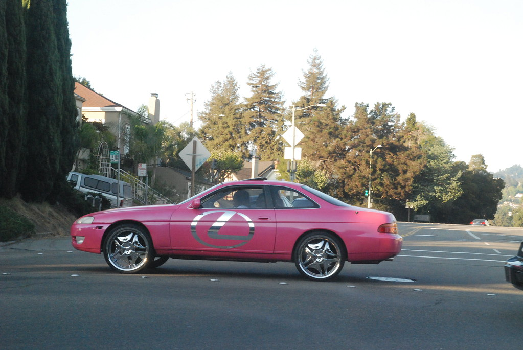 pink lexus with glittery stylings crossing park