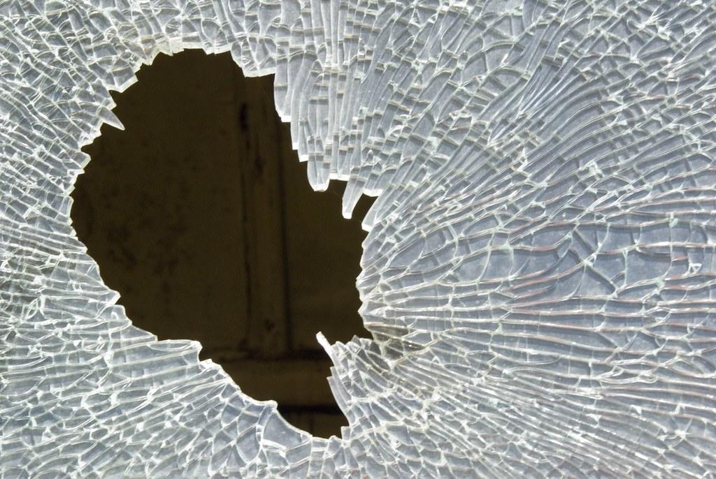 Broken Car Window Parked On Street In Whittier California