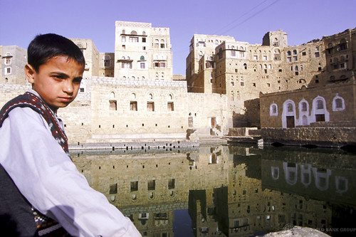 Young boy sitting by centuries old cistern in Yemeni town of Hababa. Yemen | by World Bank Photo Collection