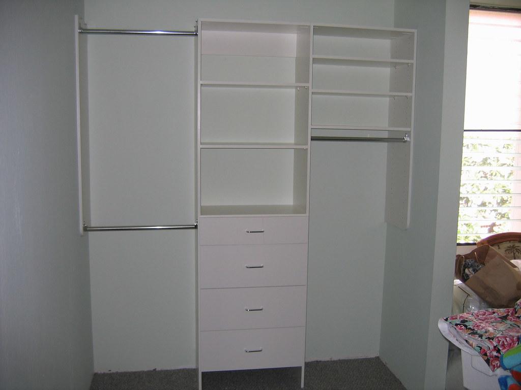 Bedroom Closet Organizers W Dressers Behind Plantation