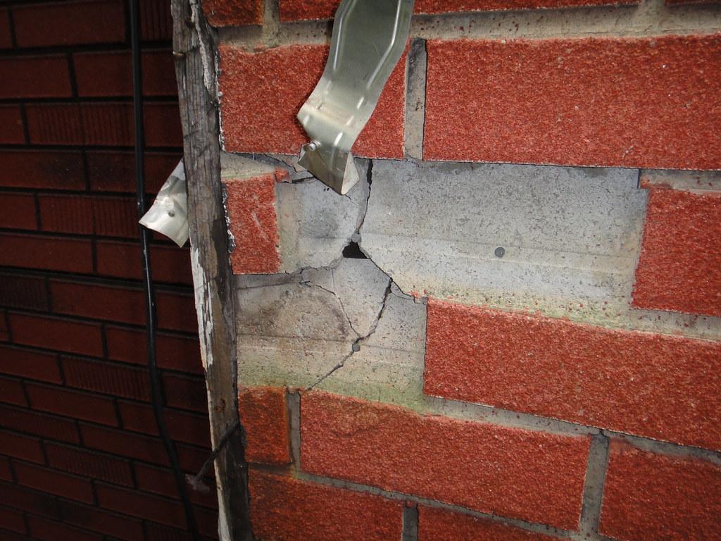 Damaged Asbestos Cement Fake Brick House Siding Example