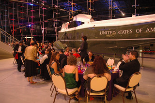 Attendees at tables with Reagan Helocopter in background | by California State University Channel Islands