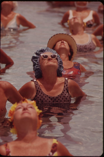 Residents Take Part in Organized Daily Exercises in One of the Public Pools at Century Village Retirement Community. | by The U.S. National Archives