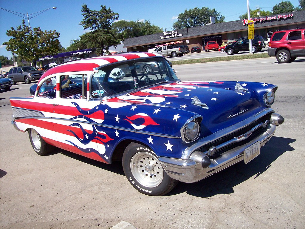 A patriotic 57 chevy parked on woodward avenue in the for American classic usa