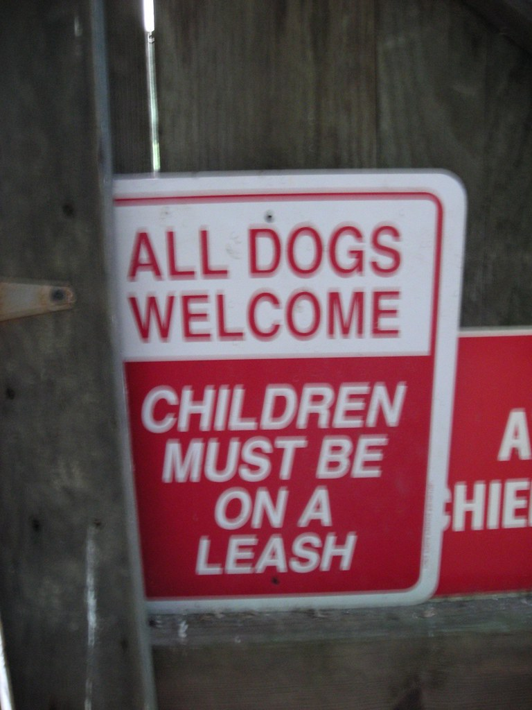 All Dogs Welcome Children Must Be On A Leash A Sign At