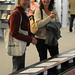 Professors Rachel Cartwright and Angela Chapman looking at the faculty biographies on display at the 2009 Celebration of Faculty Accomplishments