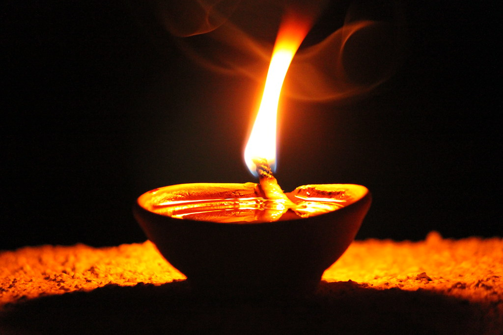 The flame from a mud diya