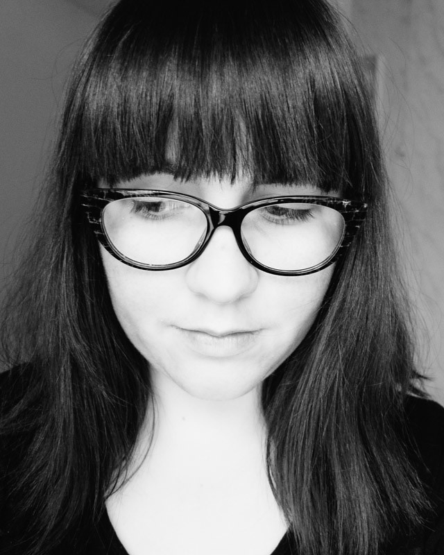 black and white photo, wearing glasses