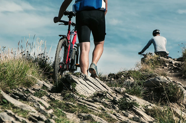 pair-mountain-biking-rocky-path