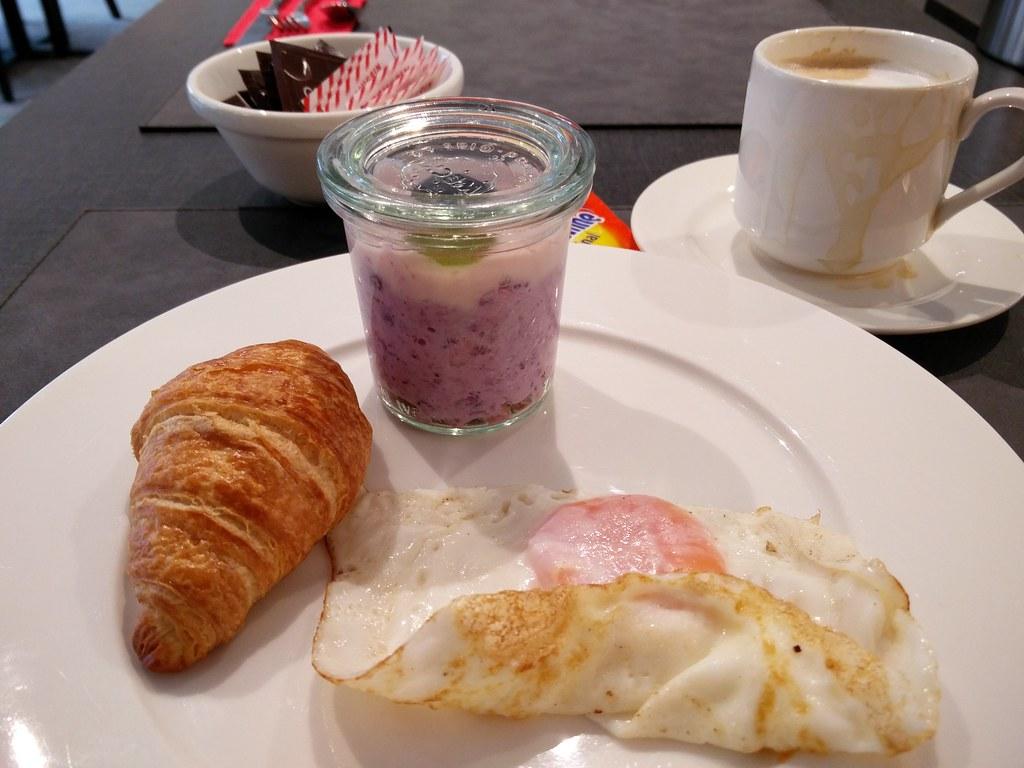 Eggs, croissant and muesli