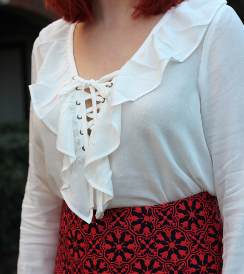 White Lace Up Blouse with Ruffles and a Red Skirt