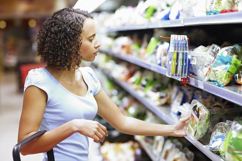 Woman shopping at supermarket