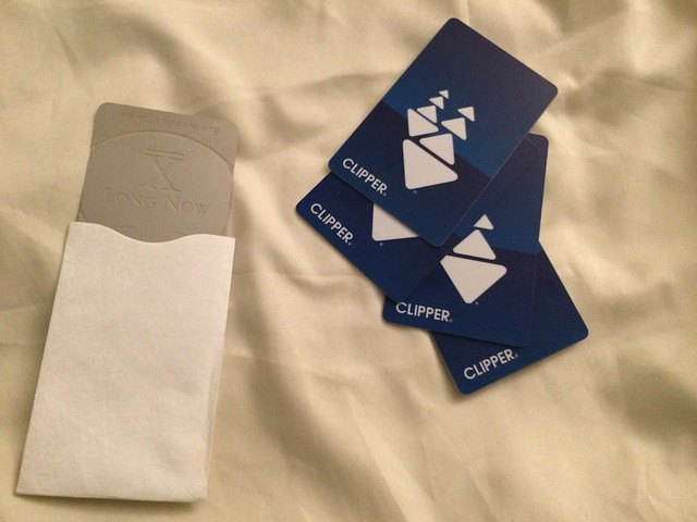 Four clipper cards and one Long Now membership card, half in its sleeve.