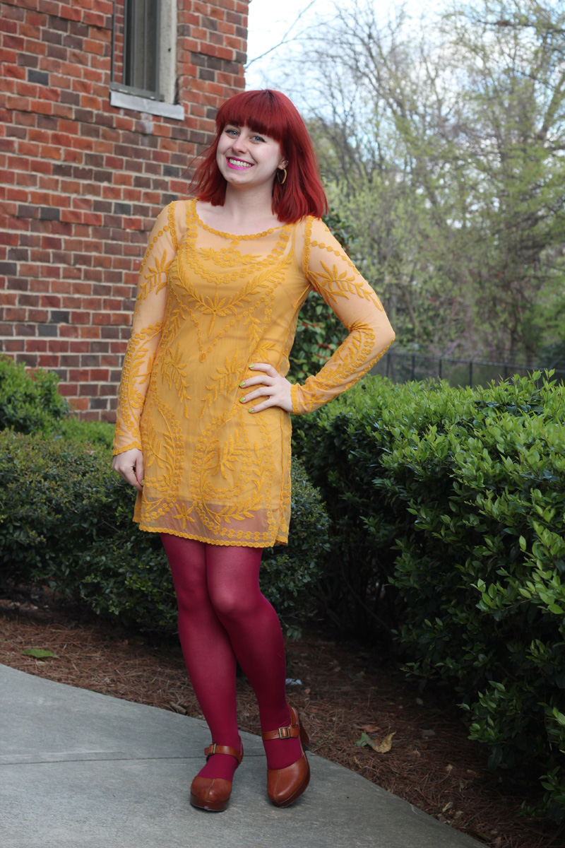 Long Sleeved Mustard Yellow Shift Dress, Bright Pink Tights, and Brown Clogs
