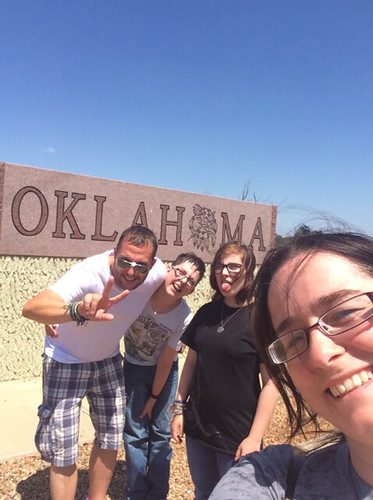 family at border sign at Oklahoma on Route 66