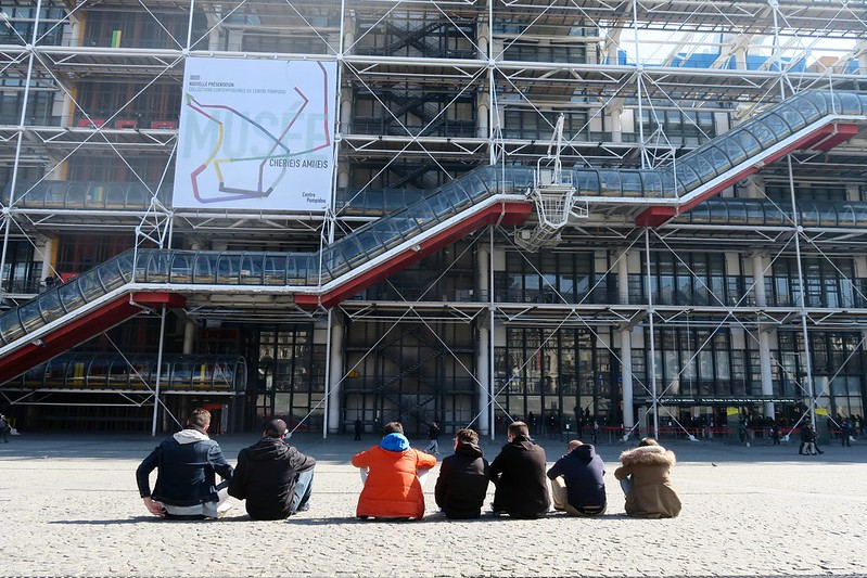 seven people sitting in front of the Pompidou