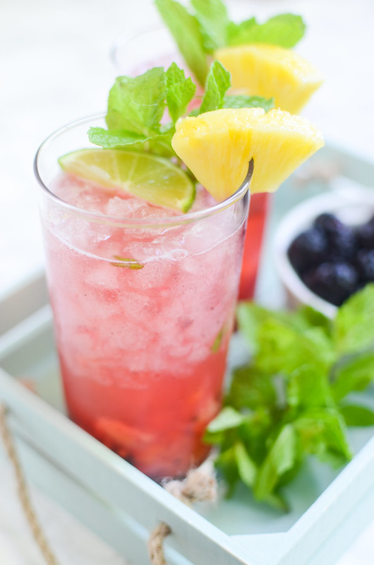 Pineapple Blackberry Mojitos - the BEST summer cocktail recipe! Pineapple, blackberries, and mint are crushed and then mixed with rum, lime juice, and sparkling water!