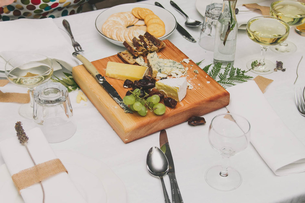 cheese board nestled amongst greenery on the tables