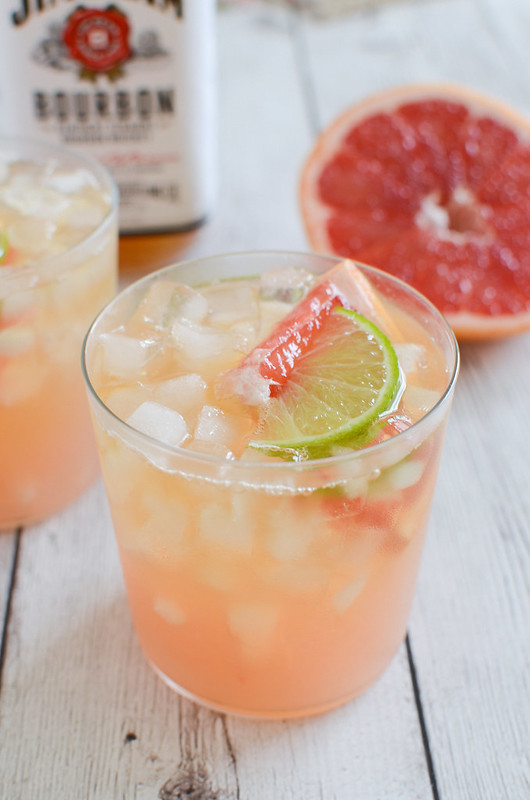 Grapefruit-Ginger Bourbon Sour - fresh grapefruit juice, lime juice, Bourbon, and an easy homemade ginger simple syrup. The most delicious tart and sweet cocktail recipe!