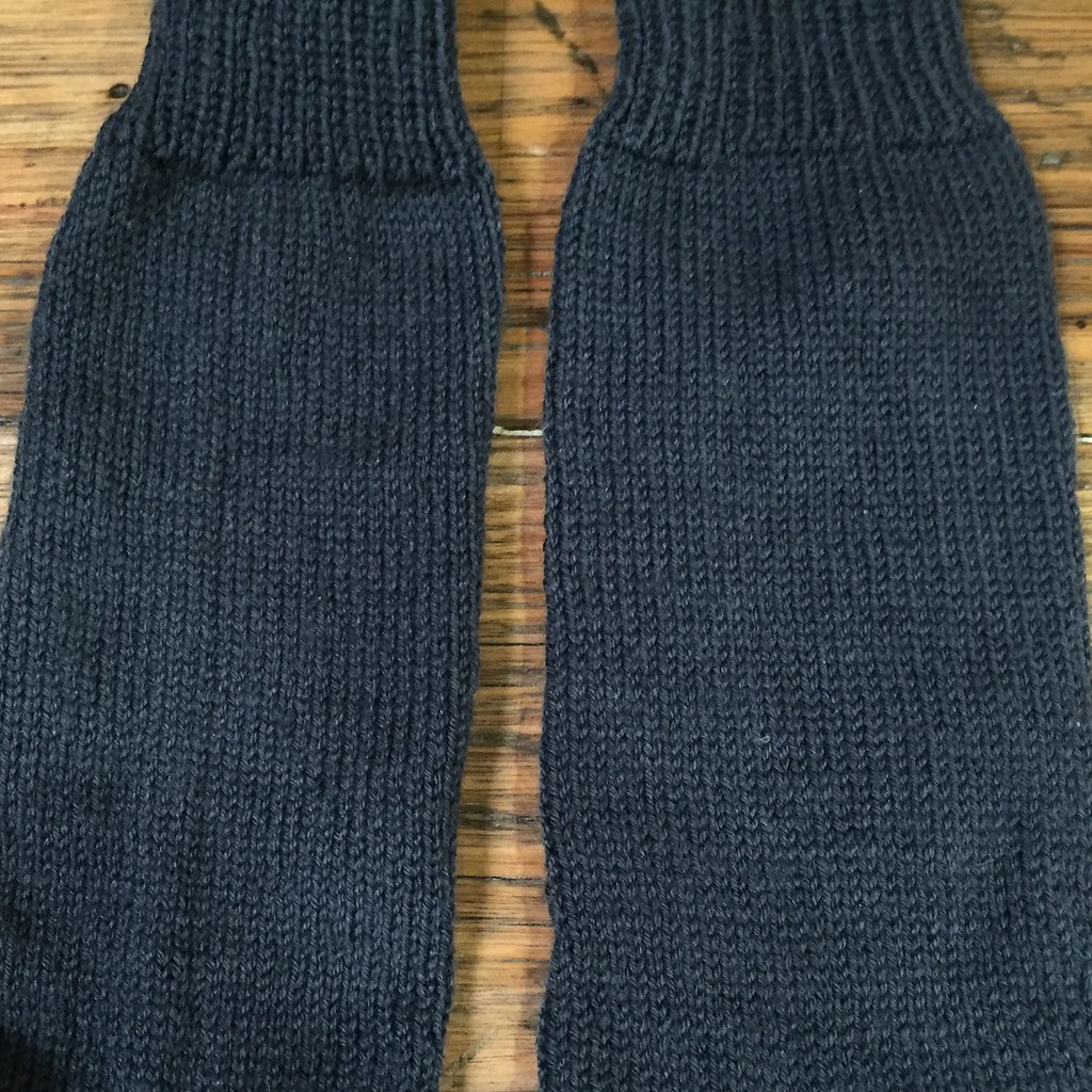 close up of leg section of a pair of socks knit in grey patonyle for my great uncle frank