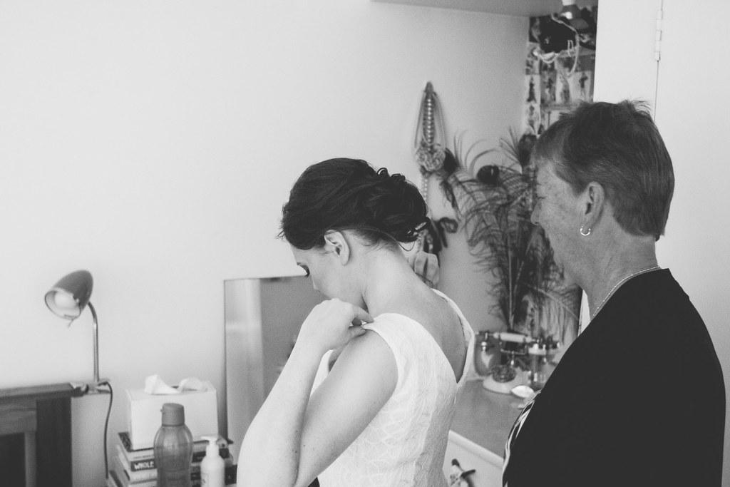 slipping into my dress with my mum on zipper duty